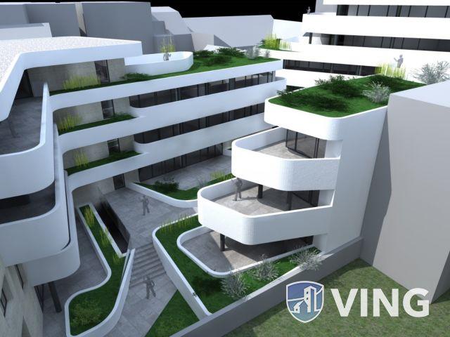 Belvárosi, új építésű földszinti lakás terasszal!